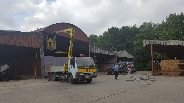 Spray painting shed off cherry picker