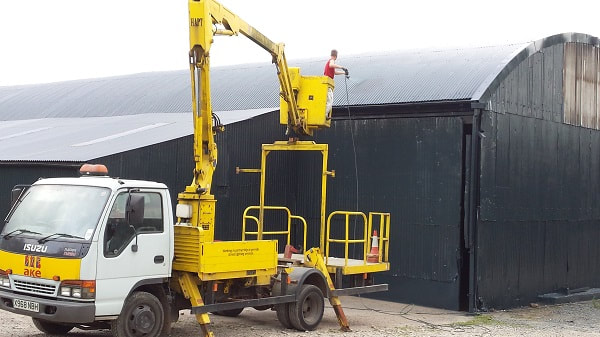 cherry picker spray painting shed